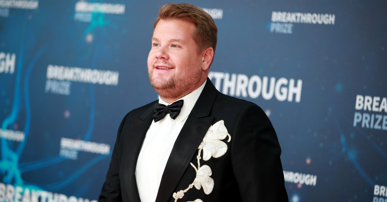 James Corden at an event in a black suit with flower embroidery