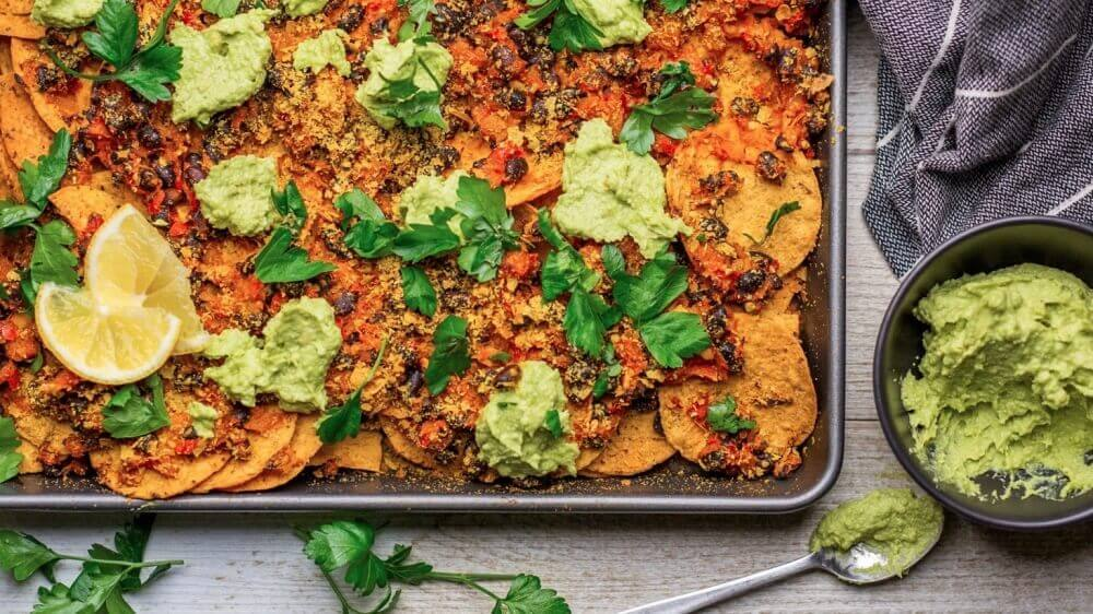 Loaded Vegan Nachos With Beans, Tomatoes and Guac
