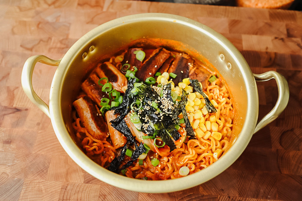 This spicy vegan Korean ramen features plant-based bacon and sausage.   Christina Ng/LIVEKINDLY