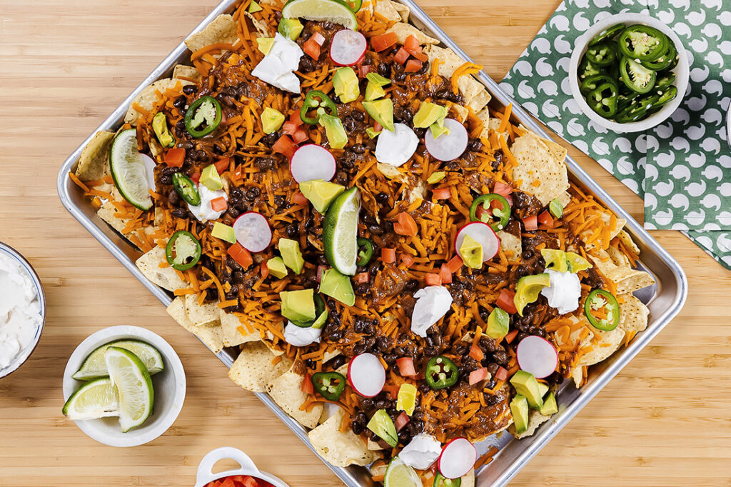 Vegan Mole Nachos Loaded With Black Beans and Melted Cheese