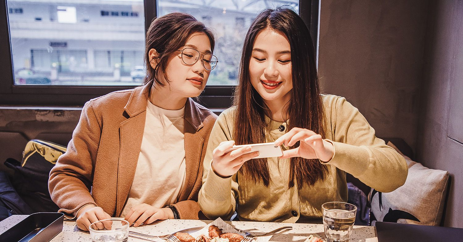 Two women dining on vegan food in china