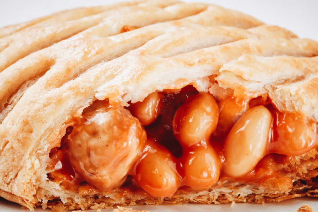 Close up photo of Greggs' new vegan Sausage, Bean, and Cheese Melt.