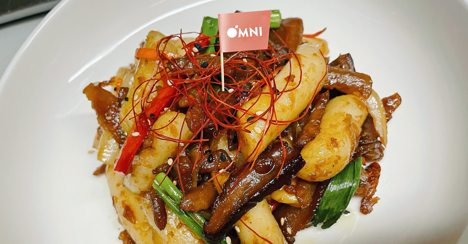 A plate of Royal Tteokbokki made by the Lucky Pig using OmniPork.