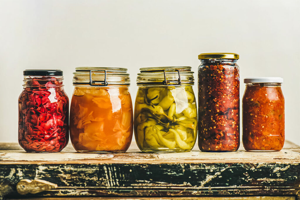 Photo features a row of jars filled with fermented vegetables and other ingredients. What is fermentation?