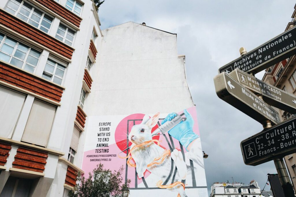 """A wall mural of a bunny being injected with the words """"Europe stand with us to end animal testing."""""""