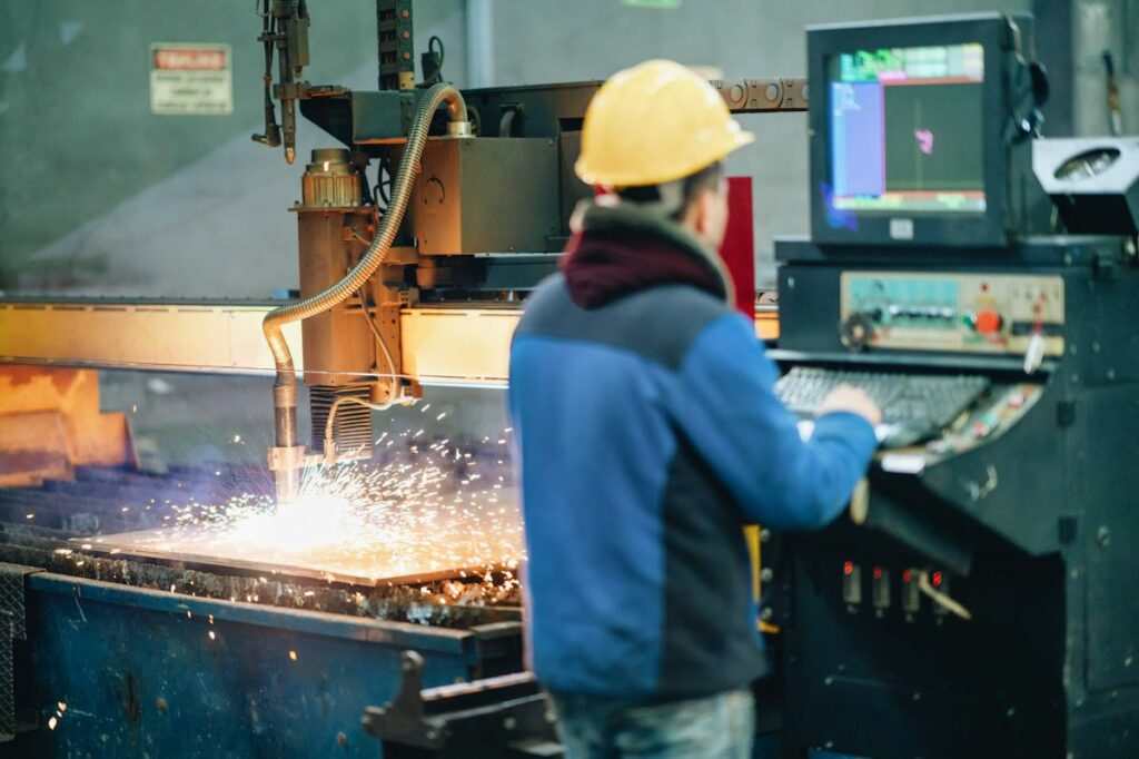 A worker produces steel in a factory