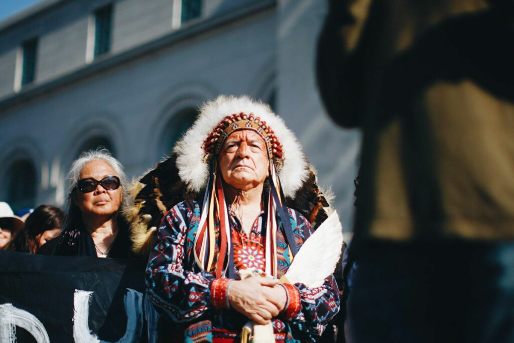 Chief Phil Lane of the Yankton Dakota and Chickasaw First Nations awaits his introduction to speak at a climate change rally.