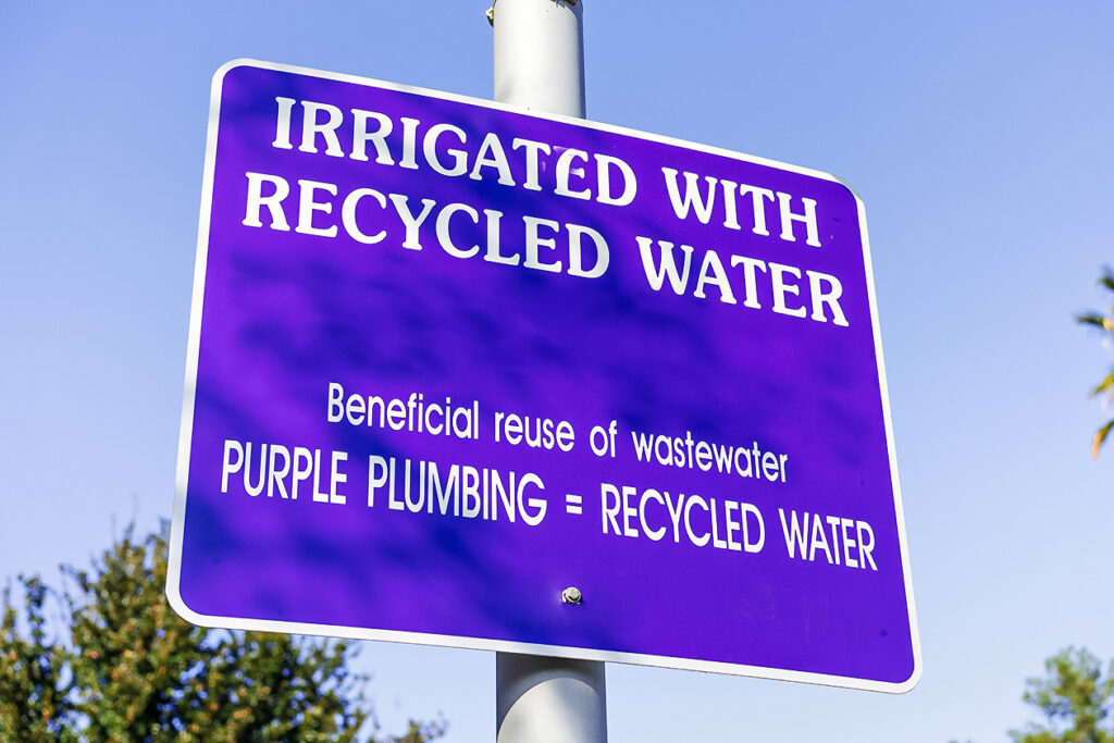 Photo of a sign that reads: irrigated with recycled water.